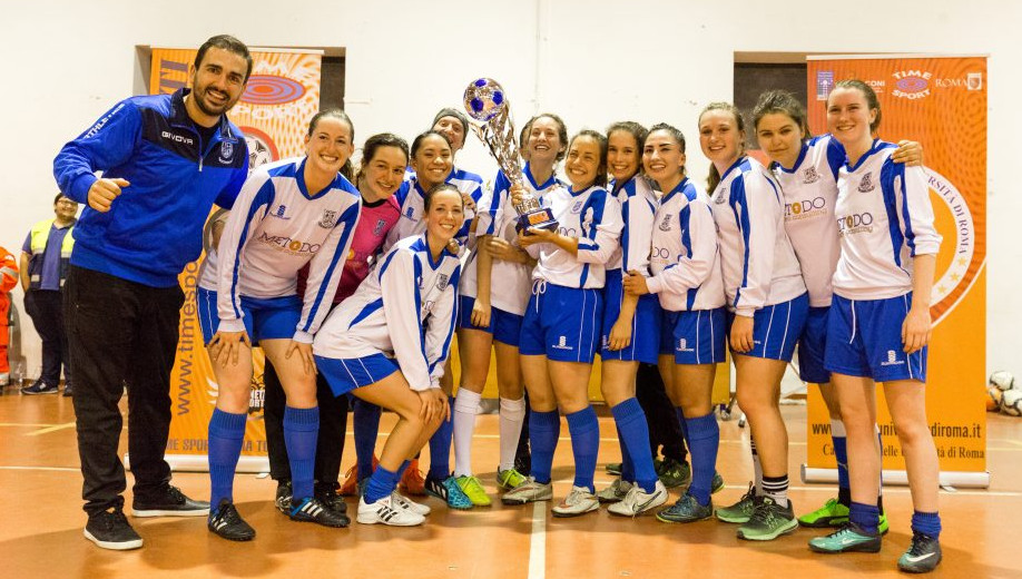 The Lady Gladiators with Atheltics Coordinator Marco Iorio with the Roman Universities League trophy