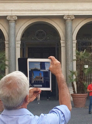 Professor Stefano Gazziano uses the Layar app in front of the church of Santa Maria in Trastevere