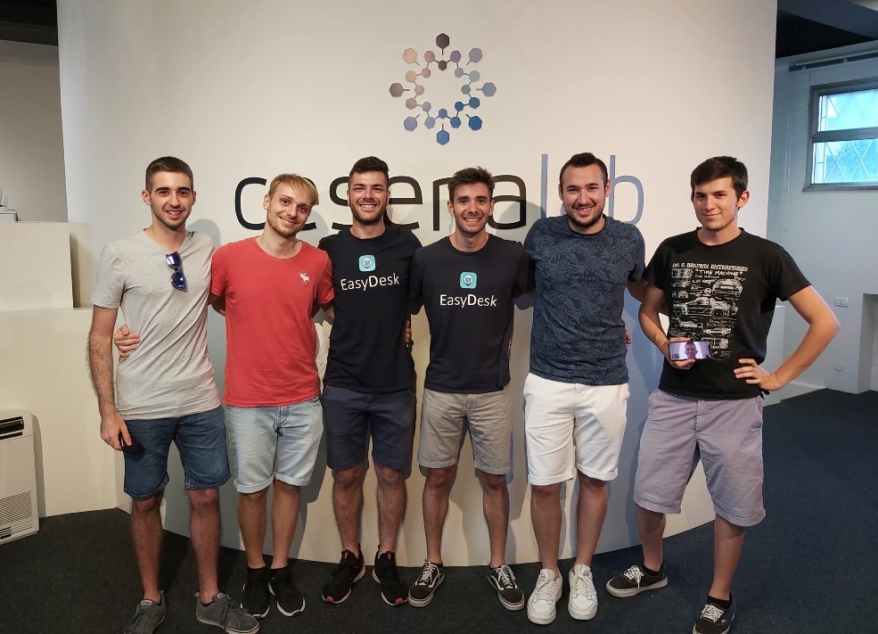 Enrico Barchiesi (fourth from left) and the EasyDesk team